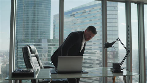 A businessman is sitting at a table in a luxurious office. A businessman in his Live Action