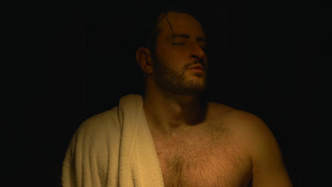Men Relaxing in Sauna, close up , breathing slowly with towel on shoulder Live Action