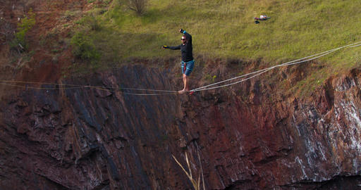 Beautiful nature around a man slacklining over a huge quarry, 4k Live Action