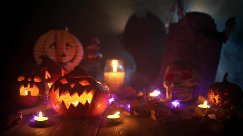 Mystical ritual decorations for the holiday of Halloween in thick smoke and Live Action