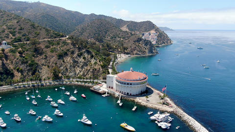 Aerial view of Catalina Casino and Avalon harbor with sailboats Live Action
