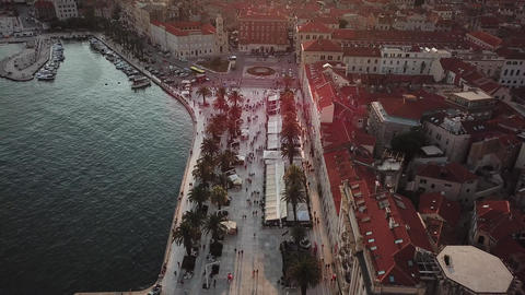 Riva Boardwalk, Split Croatia. Aerial of City Waterfront Under Sunset Sunlight Live Action