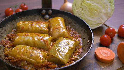 Cooking cabbage rolls. Hand held studio shot Live Action