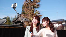Young Japanese women taking a selfie in Kawagoe, Saitama Prefecture, Japan 이미지
