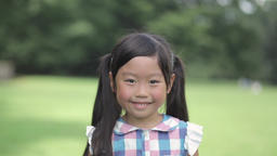 Portrait of Japanese kid in a city park Footage