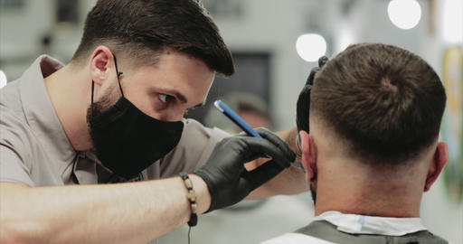 Men's haircut in a barbershop. Shaving with a dangerous razor Live Action
