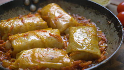 Stuffed cabbage with minced meat in tomato sauce Live Action