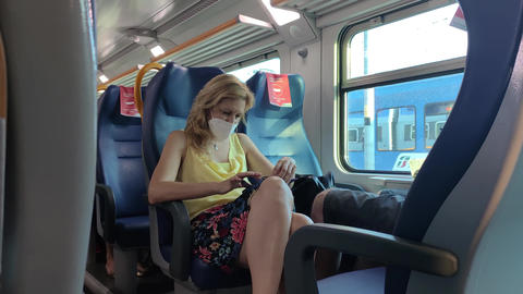 Woman wears medical mask in Train during Covid period Live Action