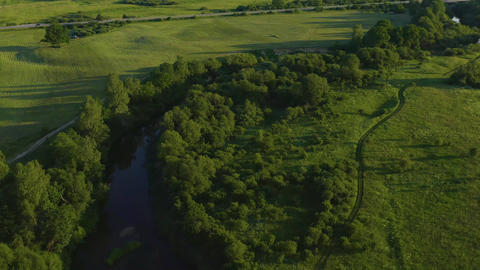 Tree-Lined River Aerial In Lithuania Live Action