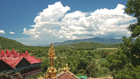Hilly Country Landscape Buddhist Temple Roofs in Vietnam Live Action