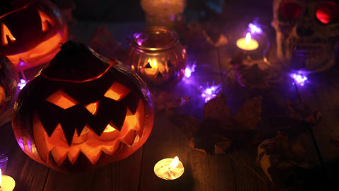 Scary pumpkin Jack with a toothy grin in the candlelight and thick smoke close Live Action