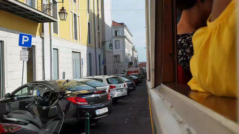 Hyperlapse of tram ride in old town centre in Lisbon, passenger window perspective Live Action