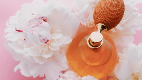 Citrus perfume bottle with peony flowers, chic fragrance scent as luxury Live Action