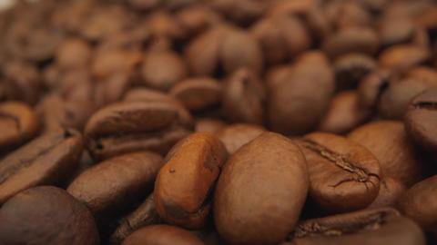 Coffee close up. Roasted coffee beans with. Coffee beans factory mixing. Macro Live Action