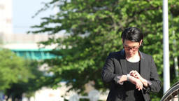 Japanese businessman walking with smartwatch Footage