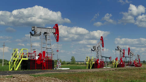 working oil pumps in row at sunny day, timelapse Footage