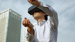 Japanese man using virtual reality device Footage