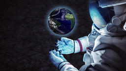 CG animation of astronaut holding small rotating planet Footage