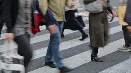Pedestrians walking at zebra crossing in Ikebukuro, Tokyo, Japan Footage