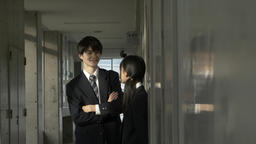 Japanese high-school students talking in the corridor outside the classroom Footage