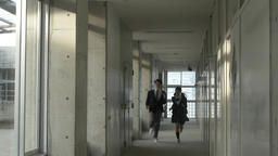 Japanese high-school students running in the corridor outside the classroom Footage