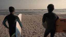 Japanese surfers looking at the sea from the beach, Chiba Prefecture, Japan Footage
