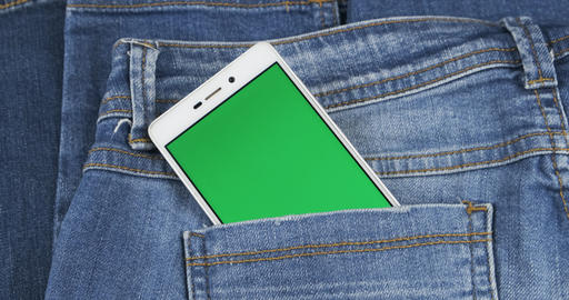 Panorama of a phone sticking out of a jeans pocket. Screen chromakey Live Action