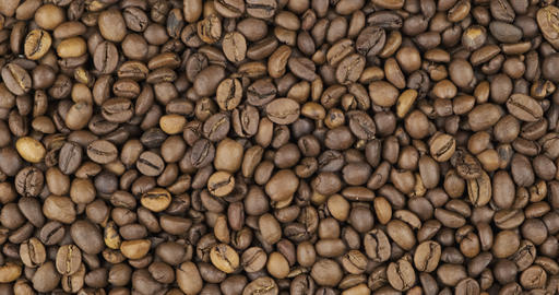 Coffee beans background, texture. Rotation and zoom out of grain background Live Action