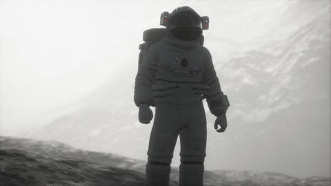astronaut on another planet with dust and fog Live Action