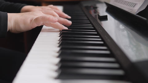 Electronic piano. Fingers press the piano keys. Music lesson. Fingers press the keys of a musical Live Action