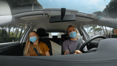 Couple of friends in car on road trip holiday Live Action