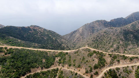 Aerial view of hiking trails on the top of Santa Catalina Island mountains Live Action