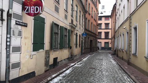 Riga, Latvia, A narrow city street with buildings on the side of a building Live Action