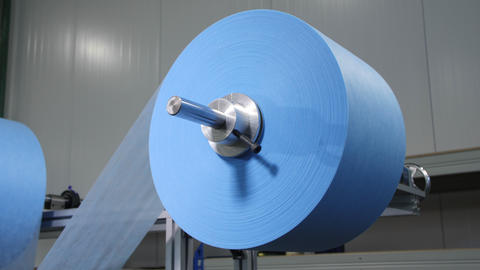 roll with strip of light blue textile to manufacture masks Live Action