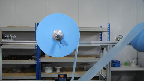 textile material roll on rod to manufacture protective masks Live Action
