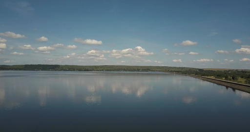 Aerial photography of a lake on a background of blue sky and white clouds city Live Action