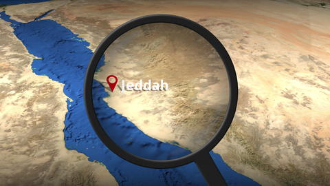 Magnifying glass finds Jeddah city on the map, 3d rendering Photo