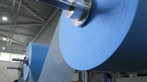 rolls of light blue material for protective masks in shop Live Action
