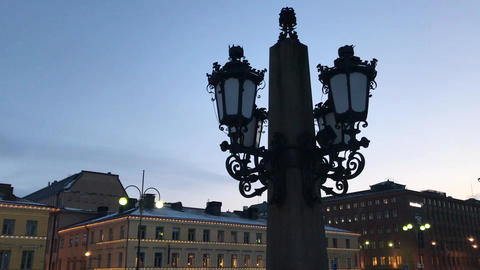 Helsinki, Finland, A large clock tower towering over a city Live Action