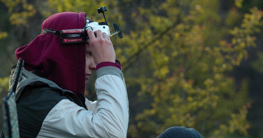 Profile shot of a man putting on the VR headset in the woods, 4k Live Action