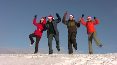 dancing friends with christmas hats on snow Stock Video Footage