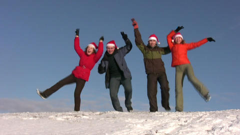dancing friends with christmas hats on snow Footage