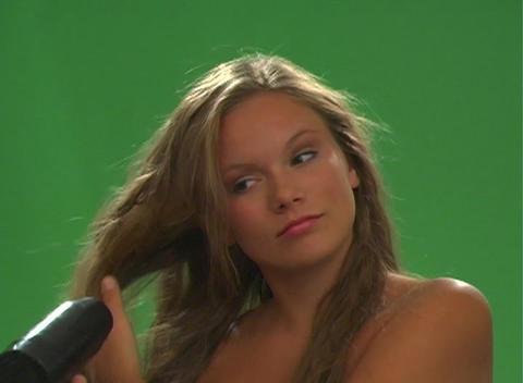 Beautiful Teen Blonde Blow-dries her Hair - Slow Motion Footage