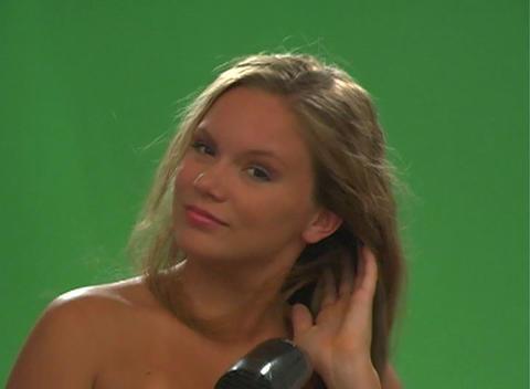 Beautiful Teen Blonde Blow-dries her Hair - Slow Motion Stock Video Footage