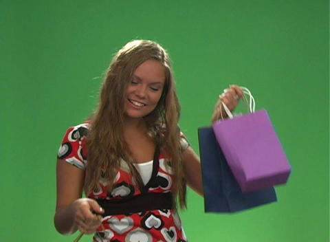 Beautiful Teen Blonde with Shopping Bags-1 Stock Video Footage