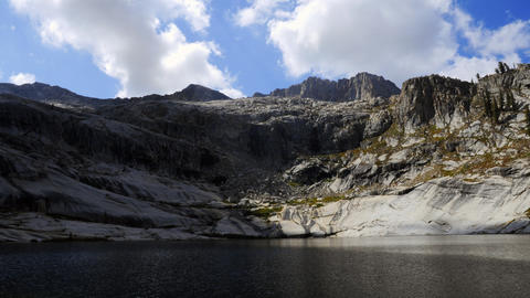 Time-lapse of clouds over the mountains and Pear Lake in Sequoia National Forest Footage