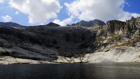 Time-lapse of clouds over the mountains and Pear Lake in... Stock Video Footage