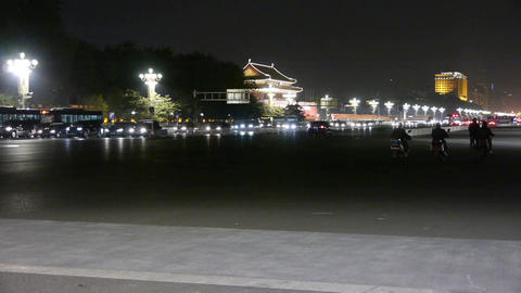 Busy China street night traffic,people riding bicycles near Beijing Tiananmen Sq Footage