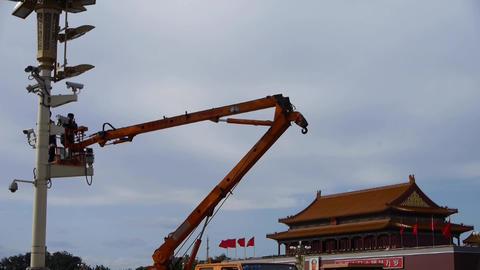 Crane repairman maintenance of Beijing Tiananmen street... Stock Video Footage