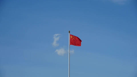 Chinese red flag flutters in wind & blue sky Stock Video Footage